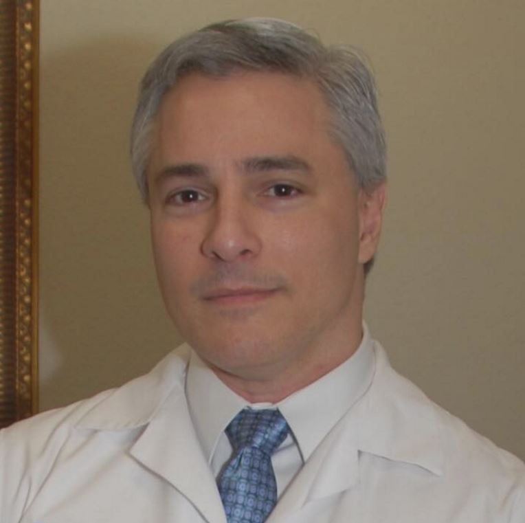 John E. Stavrakos, MS, MD
